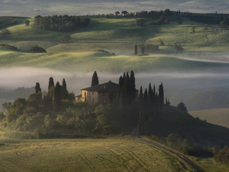 San Quirico d'Orcia – A beautiful sunrise in a foggy morning