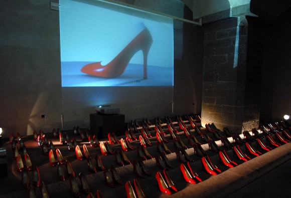 A video shows the making of the classic red stiletto