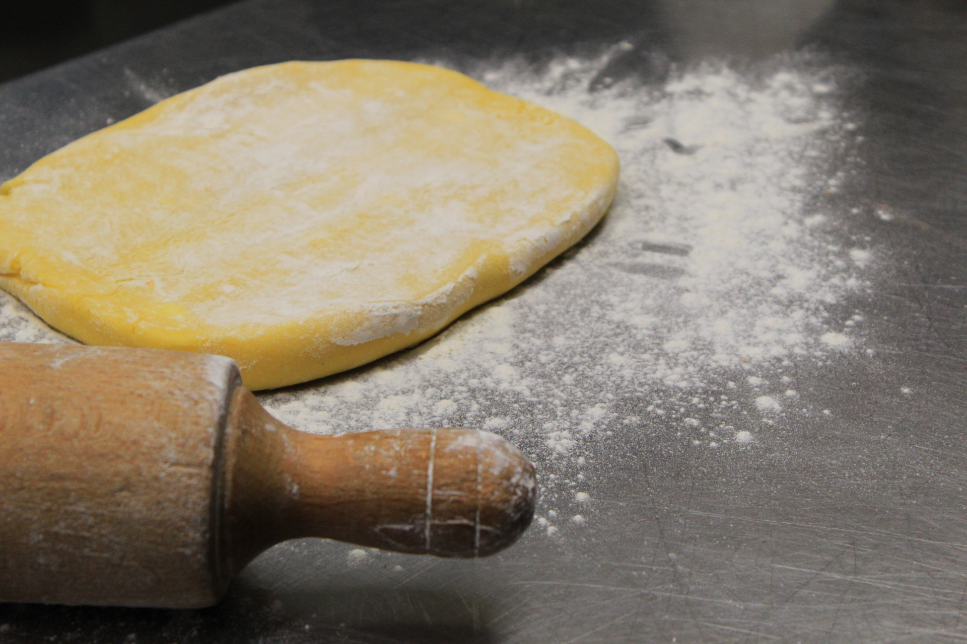 Roll out the shortcrust pastry and place it in the pan.