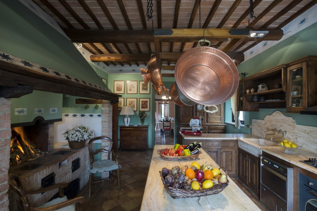 Villa Monteroni kitchen. Villa gardens has views of Siena