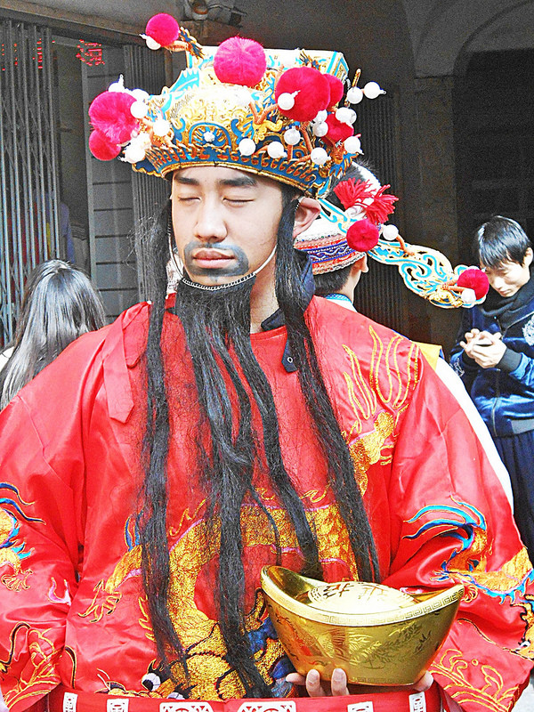 A boy in costume during the Chinese New Year in Prato