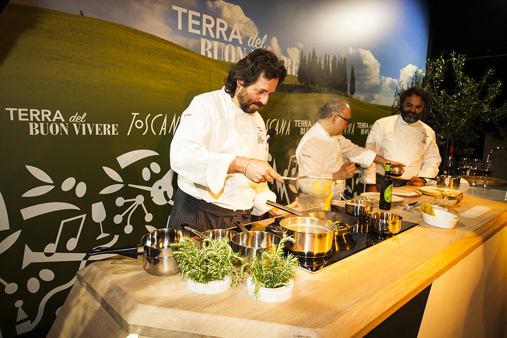 Tuscan chefs making Expotuscany 2015 official dish: pappardelle pasta with kale powder, steak extract, beans cream and wine sauce with crispy bread