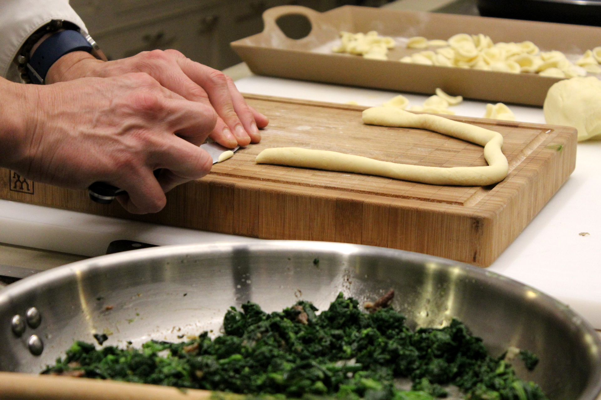 Using a knife to make the orecchiette