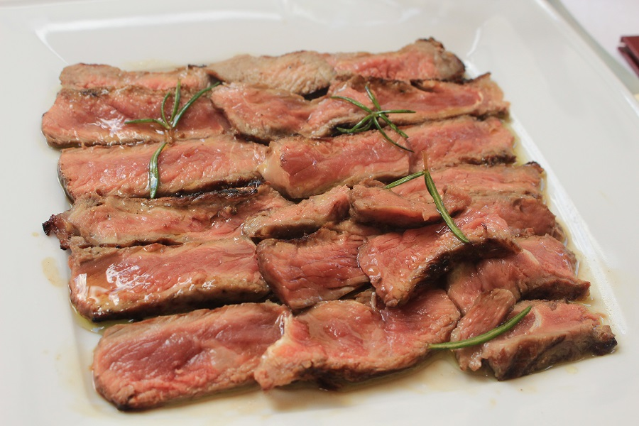 Tagliata beef seasoned with rosemary and extra virgin olive oil
