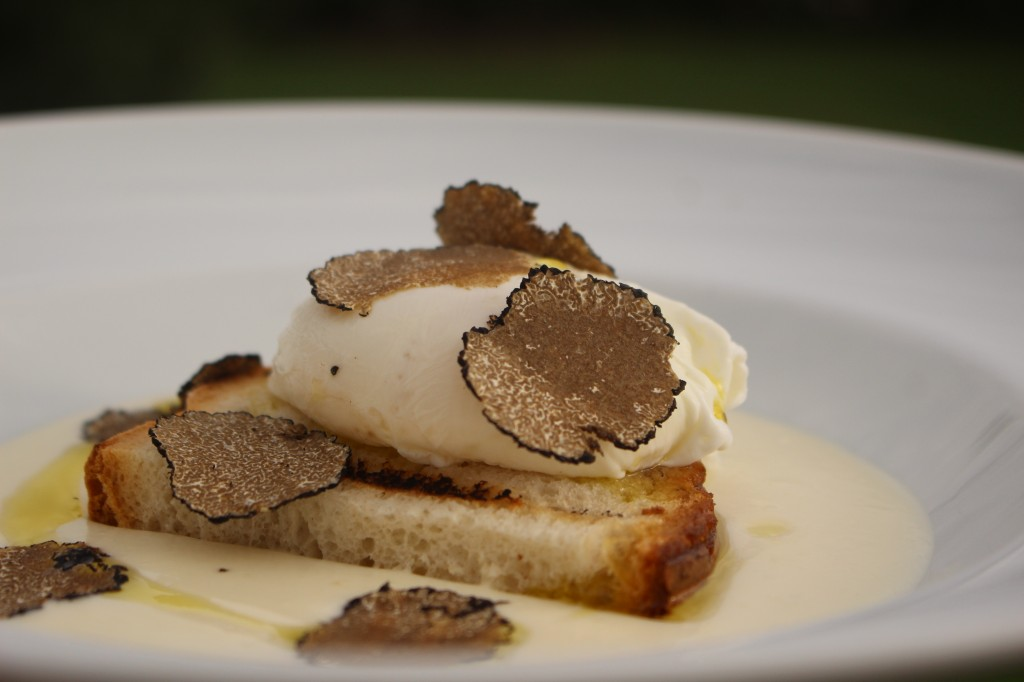 Poached egg on Pienza pecorino cheese fondue and black truffle [Photo taken at Biagio Pignatta restaurant]