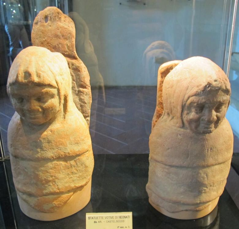 Votive statues of new-borns at the Archeological Area of Castelsecco