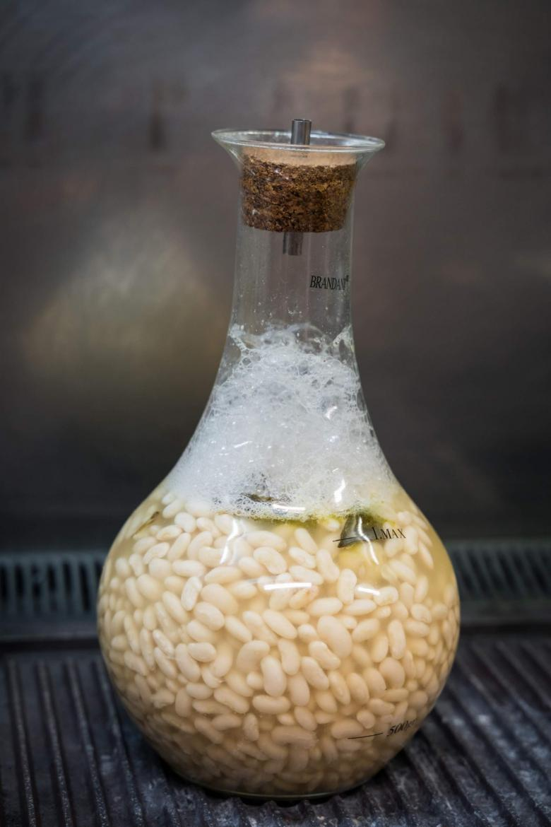 Beans cooked in a flask